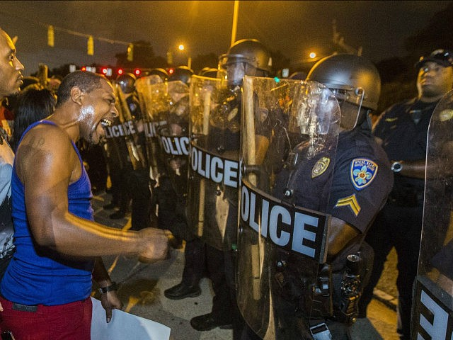 BATON ROUGE, LA -JULY 08: Protesters face off with Baton Rouge police in riot gear across the street from the police department on July 8, 2016 in Baton Rouge, Louisiana. Alton Sterling was shot by a police officer in front of the Triple S Food Mart in Baton Rouge on …