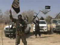 NIGERIA, UNKNOWN : A screen grab made on January 20, 2015 from a video of Nigerian Islamist extremist group Boko Haram obtained by AFP shows the leader of the Islamist extremist group Boko Haram Abubakar Shekau holding up a flag as he delivers a message. Boko Haram has claimed a …