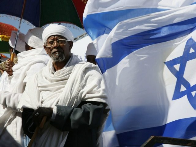 Israeli 'Kessim' or religious leaders of the Ethiopian Jewish community pray during the Sigd holiday marking the desire for 'return to Jerusalem', as they celebrate from a hilltop in Jerusalem, on November 20, 2014.