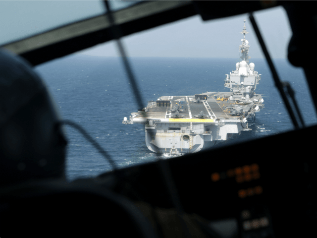 A French navy Dolphin helicopter approaches the aircraft carrier Charles de Gaulle operating in the Gulf on February 26, 2015. French warplanes carried out their first strikes on February 25, 2015 since the warship joined the fight against jihadists in Iraq. AFP PHOTO / PATRICK BAZ (Photo credit should read …