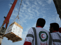 Iranian Red Crescent aid workers observe loading medical aid onto the 'Iran Shahed' ship to send to Gaza Strip in the southern port city of Bandar Abbas on December 28, 2008.
