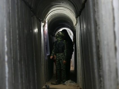 A Palestinian boy walks inside a tunnel used for military exercises during a weapon exhibition at a Hamas-run youth summer camp, in Gaza City, on July 21, 2016. / AFP / MOHAMMED ABED (Photo credit should read MOHAMMED ABED/AFP/Getty Images)
