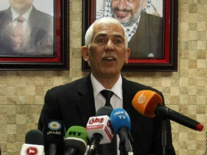 Palestinian governor of Hebron Kamel Hamid (C) speaks next to doctor Rayan al-Ali (L) who carried out the autopsy of 21-year-old Palestinian Abdul Fatah al-Sharif, who was shot in the head and killed by an Israeli soldier on March 24 as he lay on the ground while apparently seriously wounded …