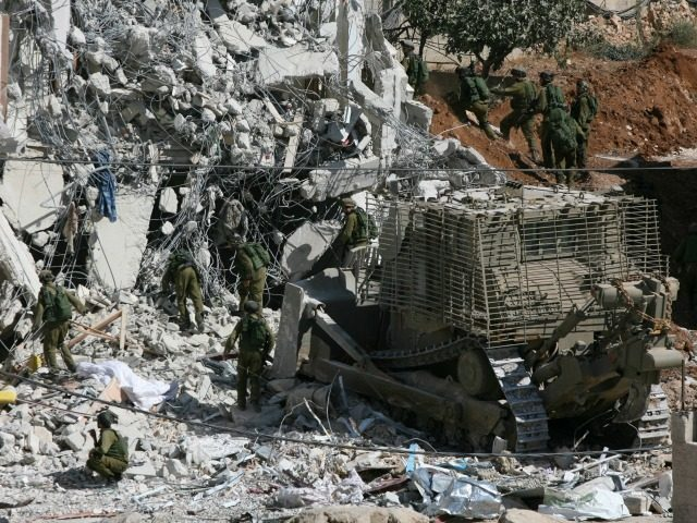 Israeli forces demolish a house during an Israeli army operation in the West Bank city of Hebron on October 8, 2010. Two Hamas militants, whom Israel said were behind an attack which left four settlers dead, were killed by Israeli troops in the southern West Bank overnight. AFP PHOTO / …