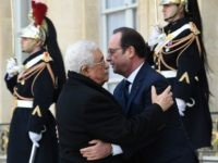 French President Francois Hollande (R) welcomes Palestinian president Mahmud Abbas (L) at the Elysee Palace before attending a Unity rally Marche Republicaine on January 11, 2015 in Paris in tribute to the 17 victims of a three-day killing spree by homegrown Islamists.