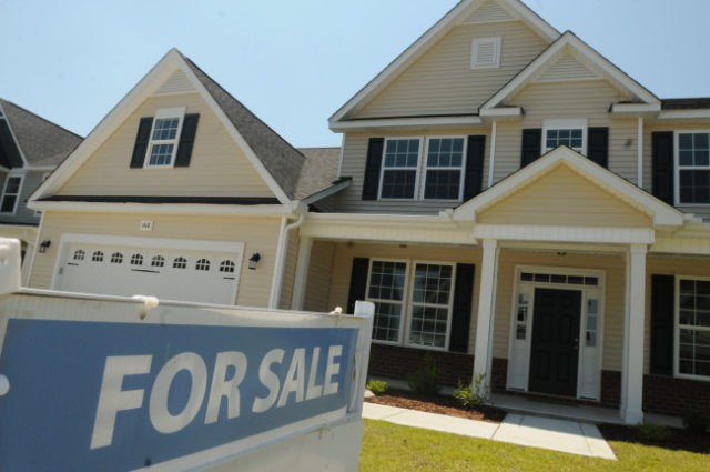 FILE - This June 19, 2014, file photo, shows a home for sale in Wilmington, N.C. Real estate data provider CoreLogic reports on U.S. home prices in July. In June, prices rose by the smallest year-over-year amount in 20 months, slowed by modest sales and more properties coming on the …