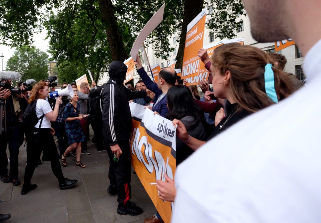 Various protesters, with differing views gathered as new PM arrives