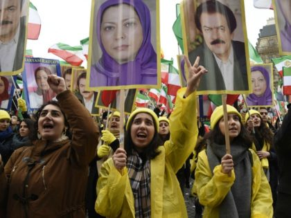 A woman holds a picture of Maryam Rajavi, president elect of National Council of Resistance of Iran (NCRI) during a demonstration denouncing Iran's use of the death penalty, on the occasion of the official visit to France by the Iranian President on January 28, 2016 in Paris.