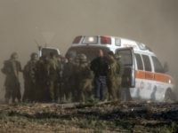 Israeli soldiers evacuate their wounded comrades at an army deployment area along the Israeli border with the Gaza Strip on July 28, 2014. The Israeli army said five of its soldiers have been killed in and around the wartorn Gaza Strip. AFP PHOTO / JACK GUEZ (Photo credit should read JACK GUEZ/AFP/Getty Images)