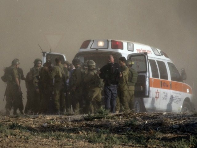 Israeli soldiers evacuate their wounded comrades at an army deployment area along the Israeli border with the Gaza Strip on July 28, 2014. The Israeli army said five of its soldiers have been killed in and around the wartorn Gaza Strip. AFP PHOTO / JACK GUEZ (Photo credit should read …