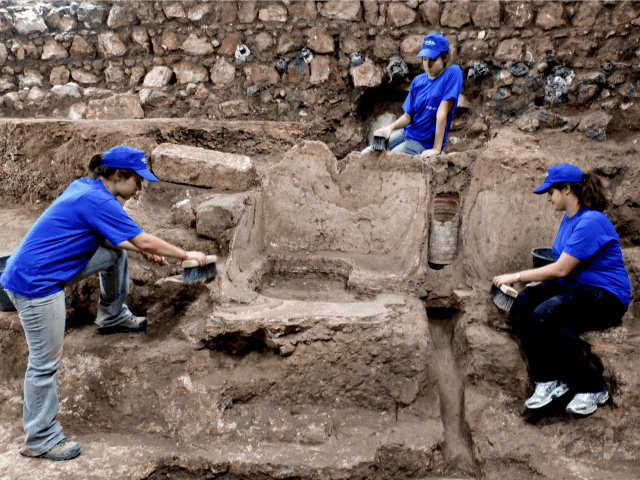In this handout photo provided by Israel Antiquities Authority, Workers labor at archaeological excavations that uncovered a 1,800 year old bathing pool on November 22, 2010 in Jerusalem, Israel. The discovery was made in the area where a miqve or male bath is to be built. (Photo by Shlomi Amami/Israel …