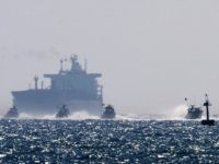 Israeli military boats approach the southern port of Ashdod on May 31, 2010, after Israeli navy commandos stormed a Gaza-bound aid flotilla in international waters, killing several pro-Palestinian activists in a pre-dawn raid that sparked global outrage. AFP PHOTO/MENAHEM KAHANA (Photo credit should read MENAHEM KAHANA/AFP/Getty Images)
