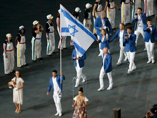 LONDON, ENGLAND - JULY 27: Israel's flagbearer Shahar Zubari holds the national flag as he leads the contingent in the athletes parade during the opening ceremony of the London 2012 Olympic Games at the Olympic Stadium on July 27, 2012 in London, England. (Photo by Fabrizio Bensch - IOPP Pool …