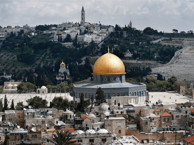 The Dome of the Rock is seen on the Al-Aqsa mosque compound surrounded by houses in Jerusalem's Old City, with the Mount of Olives in the background, on March 17, 2016. / AFP / THOMAS COEX (Photo credit should read THOMAS COEX/AFP/Getty Images)