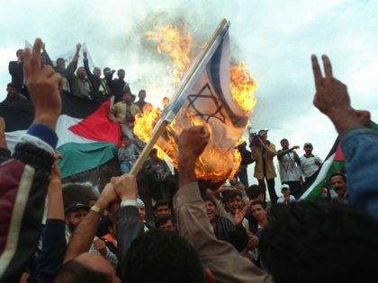 Jordanian anti-Israeli protesters burn an Israeli flag October 24, 2000 after marching in support of Palestinians toward Jordan's border with the West Bank. More than10,000 demonstrators took part in a rally where more than 20 persons were injured . The 'return march' was called to demand the right of return …