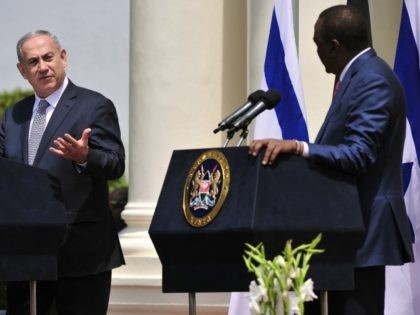 Israeli Prime Minister, Benjamin Netanyahu (L), next to Kenya's President Uhuru Kenyatta, addresses the media at a joint press conference on July 5, 2016 at the State House, in Nairobi, on the second leg of his four-nation landmark African tour. / AFP / SIMON MAINA (Photo credit should read SIMON …