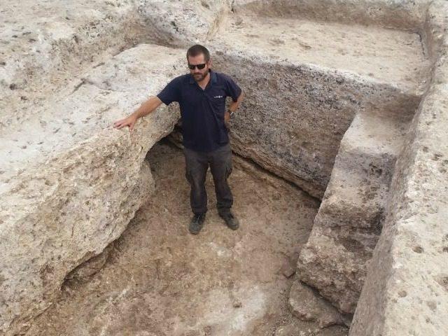 Joppe Gosker, excavation director on behalf of the Israel Antiquities Authority, inside the pottery workshop's water reservoir in Shlomi. (Royee Liran, Israel Antiquities Authority)