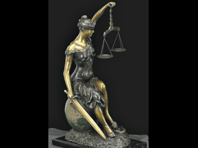 lady_justice_sitting_on_world