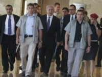 sraeli Prime Minister Benjamin Netanyahu (C) is flanked by bodyguards and unidentified aides upon his arrival at the Knesset for a meeting of the Israeli parliament's Foreign Affairs and Defense Committee in Jerusalem on June 1, 2009. Netanyahu vowed on May 31 there would be no let-up in Israel's much-criticised …
