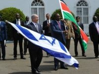Israeli Prime Minister, Benjamin Netanyahu (L) and Kenya's President Uhuru Kenyatta hold Israeli and Kenyan national flags after a join press conference in July 5, 2016 at the State House, in Nairobi.