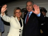 A handout picture released by the Israeli Government Press Office shows Israeli Prime Minister Benjamin Netanyahu and his wife Sara waving as they depart Israel to the United States early on May 17, 2009 at Ben Gurion Airport near Tel Aviv. Netanyahu headed to Washington for his first meeting with …