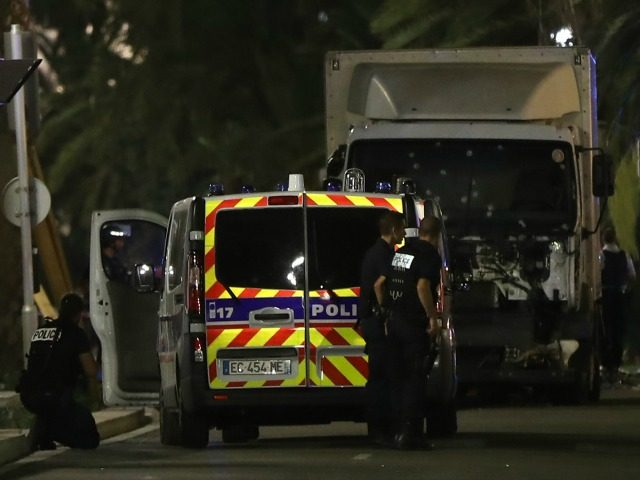 Police officers stand near a van that ploughed into a crowd leaving a fireworks display in the French Riviera town of Nice on July 14, 2016. Up to 30 people are feared dead and over 100 others were injured after a van drove into a crowd watching Bastille Day fireworks …