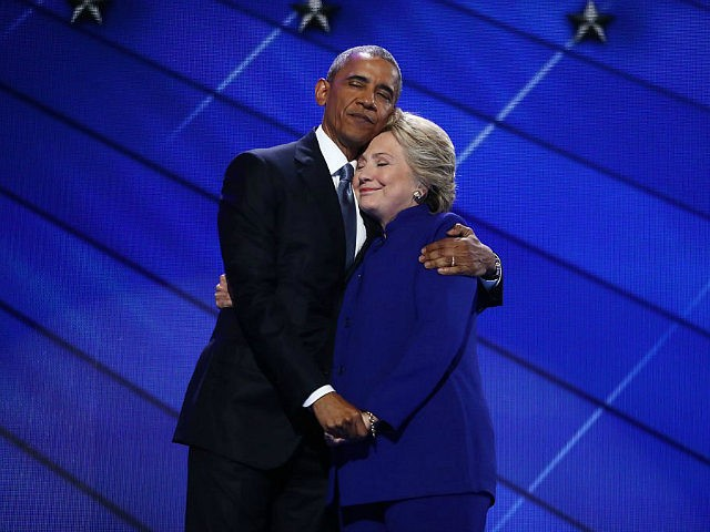 U.S. President Barack Obama hugs Hillary Clinton, 2016 Democratic presidential nominee, on stage during the Democratic National Convention (DNC) in Philadelphia, Pennsylvania, U.S., on Wednesday, July 27, 2016. With the historic nomination for the first woman to run as the presidential candidate of a major U.S. political party, Democrats gathered in Philadelphia hoped they had turned a corner on Tuesday. Photographer: Andrew Harrer/Bloomberg via Getty Images