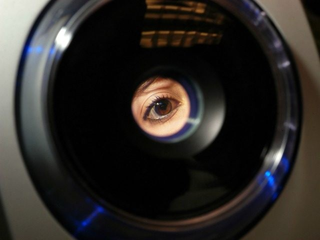 Erika Jimenez, a fourth grade teacher in the school district, has her iris recorded into the iris recognition system at Park Avenue Elementary School January 30, 2006 in Freehold, New Jersey. Iris recognition systems use a video camera to record the colored ring around the eye's pupil, identifying the unique …