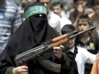 A Palestinian woman Hamas supporter hold up a rifle during a protest against the kidnapping and killing a Palestinian teenager by Israeli settlers in Jerusalem earlier in the week, and against any Israeli attack on the Gaza Strip in the Jabalya refugee camp, in northern Gaza, on July 4, 2014.