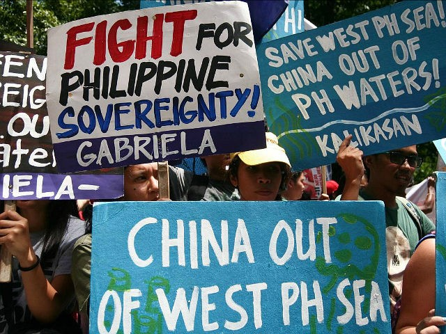 MAKATI, METRO MANILA, PHILIPPINES - 2016/07/12: Activists staged a protest rally in front of the Chinese consulate in Buendia Avenue, Makati City, to assert the Philippines sovereignty over the contested islands in the South China Sea. The International Court of Permanent Arbitration just recently announced that it has awarded to …