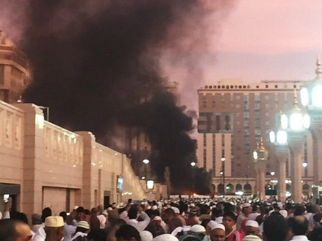 In this photo provided by Noor Punasiya, people stand by an explosion site in Medina, Saudi Arabia, Monday, July 4, 2016. State-linked Saudi news websites reported an explosion Monday near one of Islam's holiest sites in the city of Medina, as two suicide bombers struck in different cities. (Courtesy of …