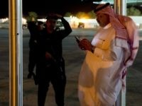 A Saudi man using a cellphone stands near Marine One, with US President Barack Obama aboard, as he departs meetings with King Abdullah of Saudi Arabia at the King's Desert Camp at Rawdat Khuraim outside Riyadh, Saudi Arabia, March 28, 2014. AFP PHOTO / Saul LOEB (Photo credit should read …