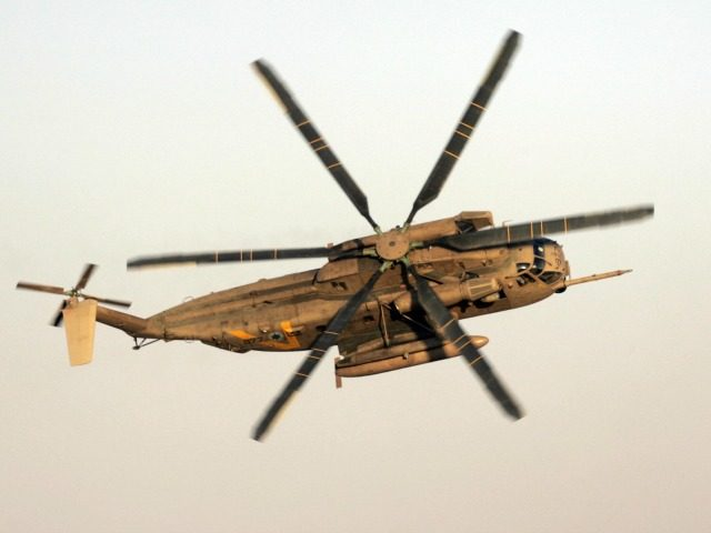 An Israeli air force CH-53 Sea Stallion heavy-lift transport helicopter (also known as the Sikorsky S-65 or 'Yasur' in Hebrew) banks in the air during an air show at a graduation ceremony for Israeli air force pilots at the Hazerim air force base near the southern Israeli city of Beersheva …