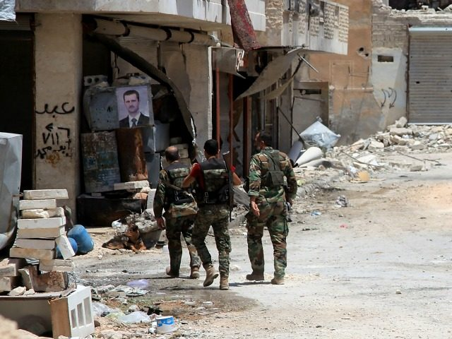 Syrian army soldiers patrol in government-controlled Aleppo's al-Khalidiya area where the army progressed towards the industrial zone of al-Layramoun and Bani Zeid on June 28, 2016. Aleppo was once the country's commercial hub but now lies divided between government forces in the west and rebels in the east. / AFP …
