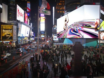 People walk underneath a giant new advertising screen in Times Square, New York, in this November 20, 2014 file photo. REUTERS/Carlo Allegri People walk underneath a giant new advertising screen in Times Square, New York, in this November 20, 2014 file photo. REUTERS/CARLO ALLEGRI