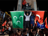 Pro Erdogan supporters hold Turkish national and Ottoman flags during a rally at Taksim square i istanbull on July 20, 2016 following the failed military coup attempt of July 15. Turkish President Recep Tayyip Erdogan on July 20, 2016 vowed that democracy would not be compromised in Turkey despite declaring a three month state of emergency in the wake of a coup. 'We have never made compromises on democracy. And we will never make' them, Erdogan told a news conference in Ankara. / AFP / DANIEL MIHAILESCU (Photo credit should read DANIEL MIHAILESCU/AFP/Getty Images)