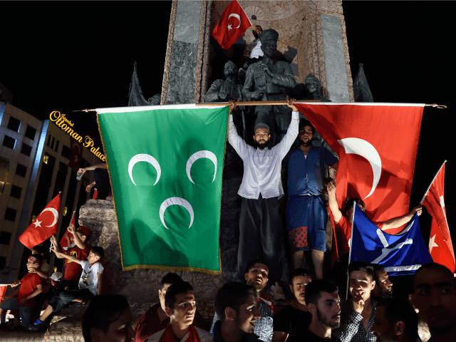 Pro Erdogan supporters hold Turkish national and Ottoman flags during a rally at Taksim square i istanbull on July 20, 2016 following the failed military coup attempt of July 15. Turkish President Recep Tayyip Erdogan on July 20, 2016 vowed that democracy would not be compromised in Turkey despite declaring …