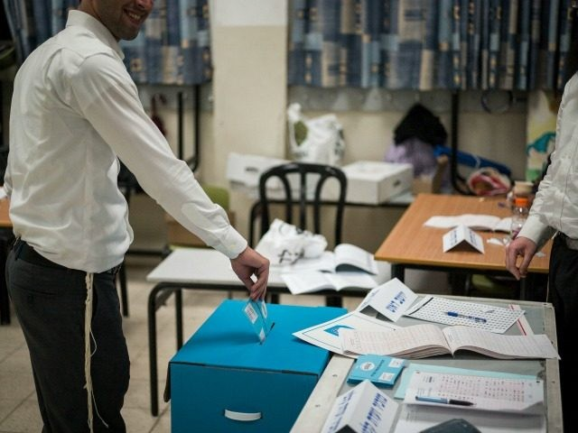 An orthodox Jew casts his ballot on election day for the 20th Knesset on March 17, 2015 in Bnei Brak, Israel. Israel's general election voting has begun today as polls show on that Chairman of the Zionist Union party, Isaac Herzog stands as the only rival to current Prime Minister …