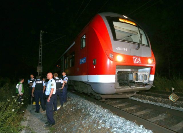 Police officers stand near a regional train in Wuerzburg, southern Germany,  on July 18, 2016 after a man attacked train passengers with an axe