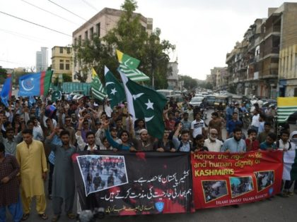 """Supporters of Pakistan's Islamist party Jamaat-e-Islami march at a rally to show solidarity with Indian Kashmiri Muslims, as they observed a """"Black Day"""" to denounce the actions of Indian security forces in Kashmir, in Karachi on July 20, 2016"""