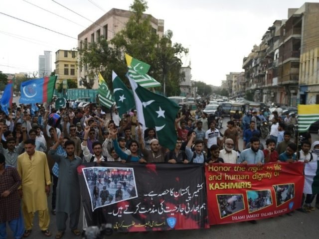 "Supporters of Pakistan's Islamist party Jamaat-e-Islami march at a rally to show solidarity with Indian Kashmiri Muslims, as they observed a ""Black Day"" to denounce the actions of Indian security forces in Kashmir, in Karachi on July 20, 2016"