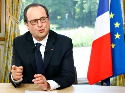 French President Francois Hollande gestures during an interview following the Bastille Day parade in Paris, on July 14, 2016