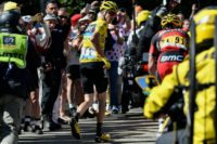 Chris Froome runs up Mont Ventoux after falling during the 12th stage of the Tour de France between Montpellier and Chalet-Reynard, on July 14, 2016