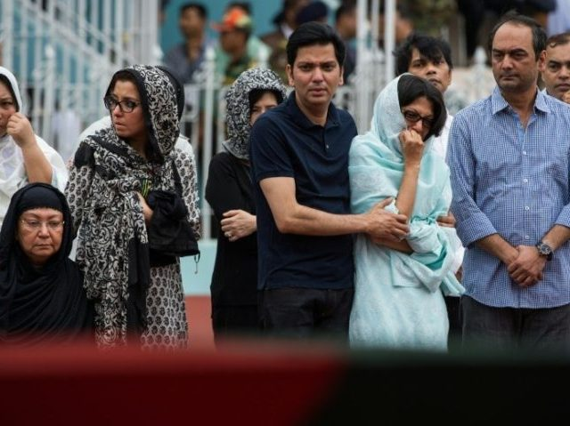 Family members of a Bangladeshi policeman mourn for him during a memorial service for those killed in a bloody attack and siege in the capital Dhaka on July 4, 2016