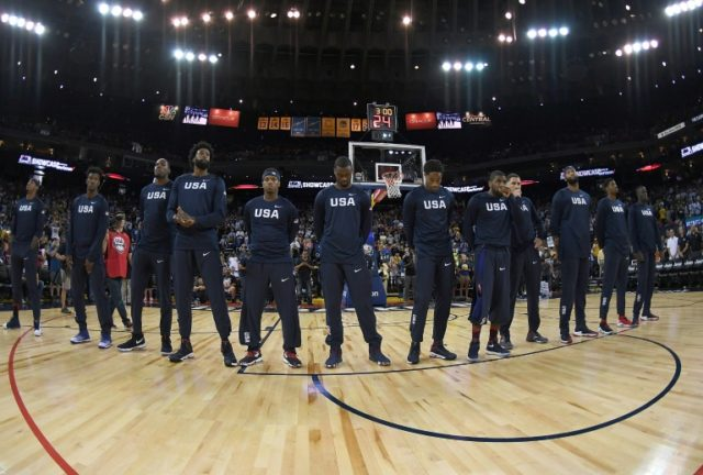 The United States Men's National Basketball Team stand together during the playing of the National Anthem prior to facing off with the China Men's National Team in a USA Basketball showcase exhibition game at the Oracle Arena in Oakland, California