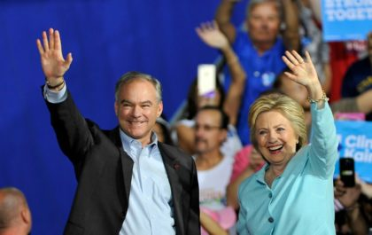 US Democratic presidential candidate Hillary Clinton and running mate Tim Kaine greet supporters at a campaign rally in Miami on July 23, 2016