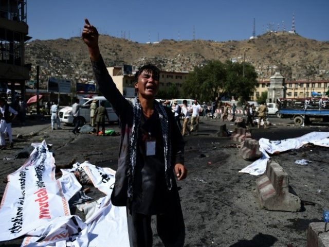 A protester screams near the scene of a suicide attack that targeted crowds of minority Shiite Hazaras during a demonstration at the Deh Mazang Circle in Kabul on July 23, 2016