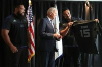 US Vice President Joe Biden receives a personalised All Black rugby jersey from players Jerome Kaino (R) and Charlie Faumuina