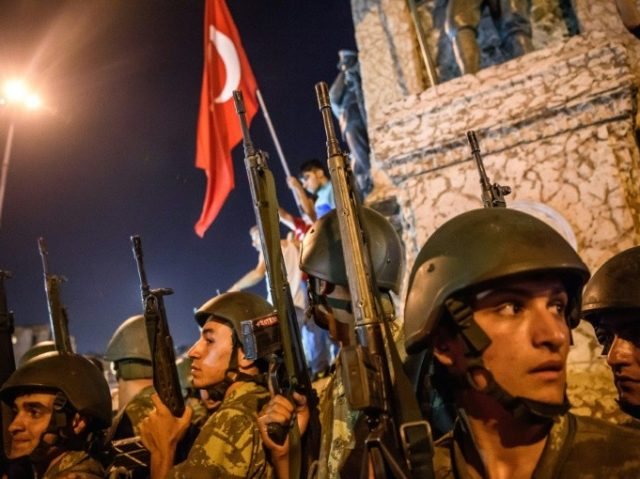 Turkish soldiers deploy in Taksim square as people protest against the military coup in Istanbul on July 16, 2016