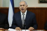 Israeli Prime Minister Benjamin Netanyahu opens the weekly cabinet meeting at his Jerusalem's office on July 3, 2016